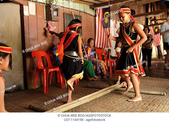 Bidayuh girls are performing bamboo dance at Annah Rais's long house during Gawai Festival(Harvesting Season), Sarawak, Malaysia