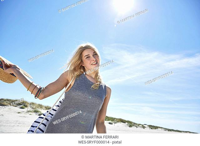 Portrait of young woman on the beach