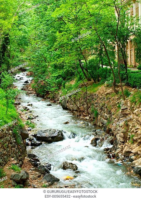 Forest stream running over rocks in Tehran, Iran