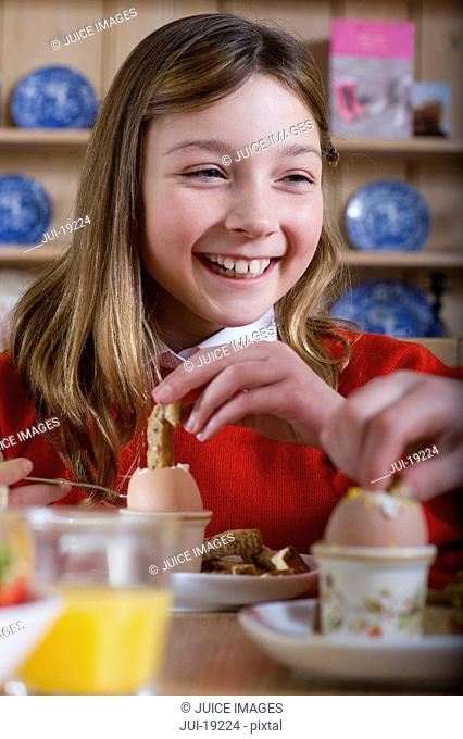 Girl in school uniform having breakfast