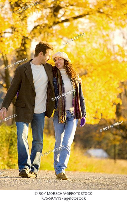 Couple smiling and walking country road