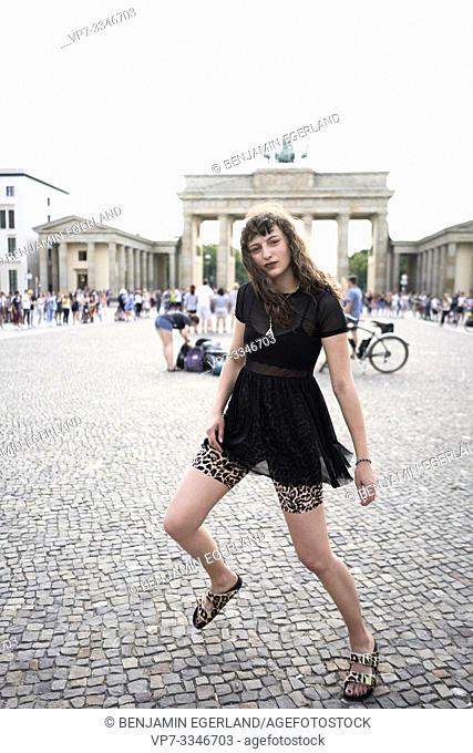 young woman in front of Brandenburg Gate, in Berlin, Germany
