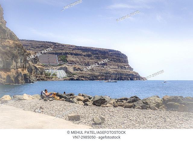 Dreamy soft focus shot of rocky coastline of Puerto de Mogan and Puerto Rico, Gran Canaria, Canary ISlands, Spain