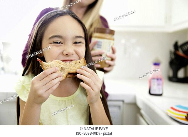 Girl eating sandwich smiling