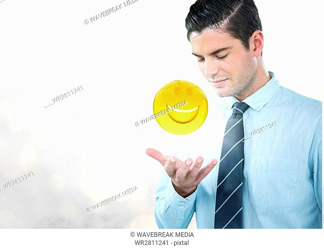 Business man with hand open and emoji with flare against white bokeh