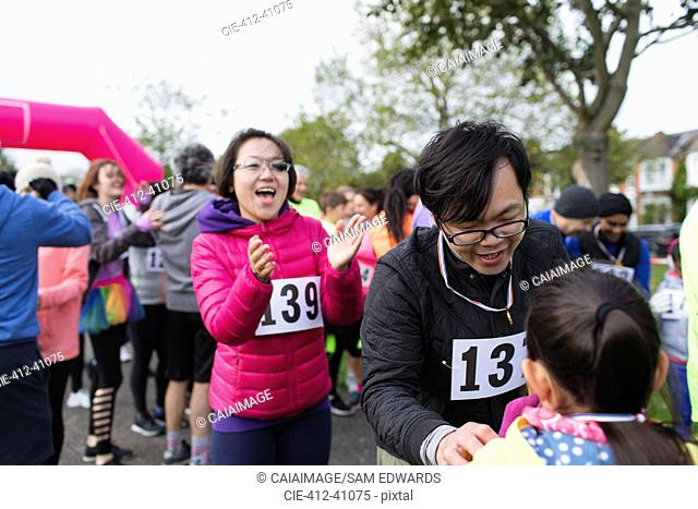 Family runners at charity run in park