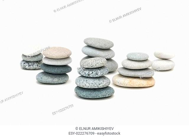 Stacks of pebbles isolated on the white