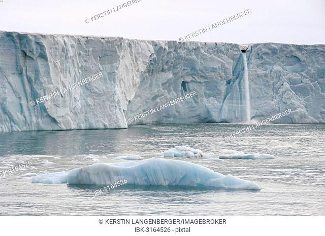 Waterfall of meltwater at the glacier front of Bråsvellbreen, the longest glacier front in the northern hemisphere, Austfonna, Nordaustlandet