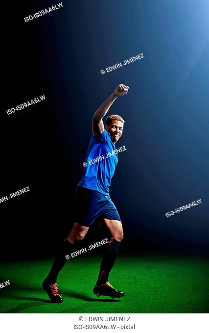 Young male soccer player celebrating