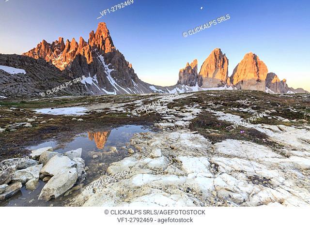 Dawn illuminates the Three Peaks and Mount Paterno reflected in the lake. Sesto Dolomites Trentino Alto Adige Italy Europe