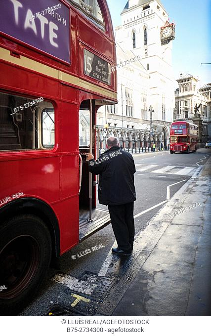 1958-1968 Routemaster buses. Conductor standing beside bus. The Strand, London, England