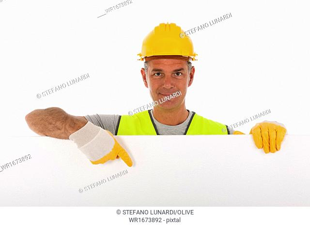 Construction worker wearing hard hat and vest