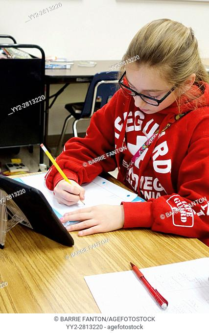 6th Grade Girl Using iPad for Lesson, Wellsville, New York, USA