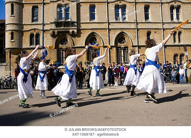 Morris dancers in action at the Oxford Folk Festival, dancing on Broad Street in front of Balliol college