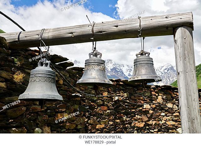 "Bells of the medieval Georgian Orthodox St George Church ""JGRag"" with mount Shkhara (5193m) behind, Ushguli, Upper Svaneti, Samegrelo-Zemo Svaneti, Mestia"