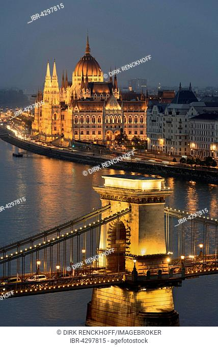 View at dusk from Buda on the Chain Bridge, Pest riverbank and Parliament, Budapest, Hungary