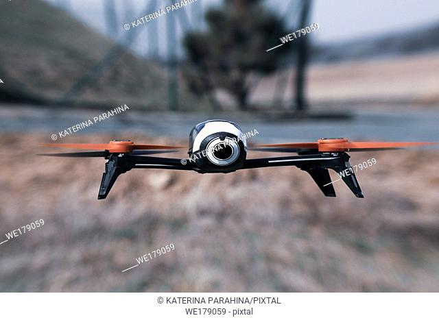 Flying drone with mounted camera outdoor
