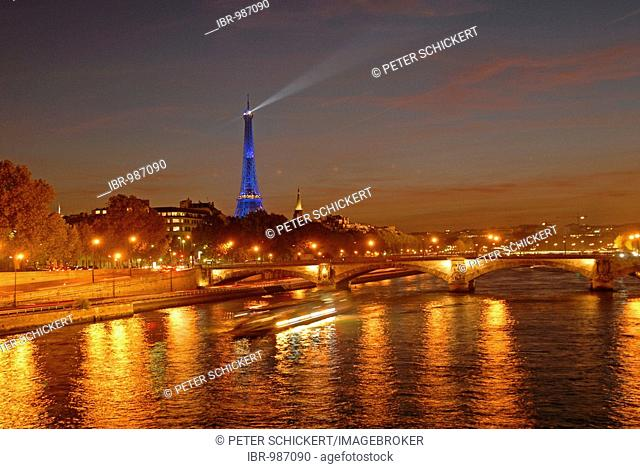 Illuminated Seine bridge and Eiffel Tower by night, Paris, France, Europe