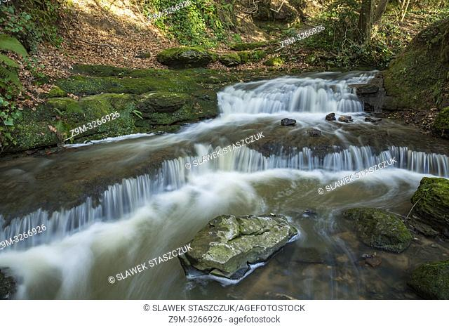 Waterfall on river Stor in West Sussex, England
