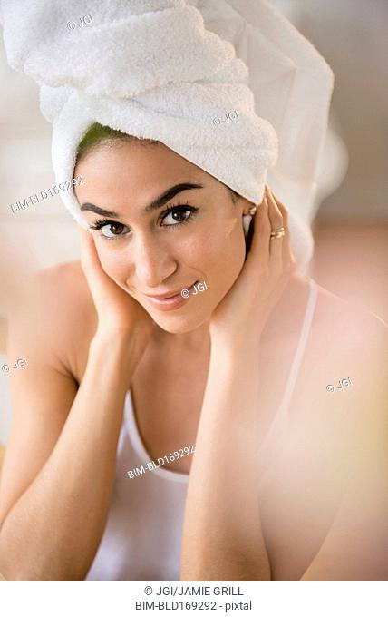 Woman drying her hair with towel