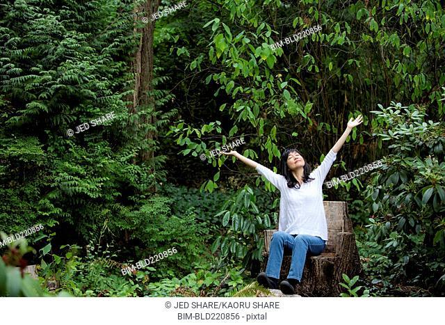 Japanese woman cheering in garden
