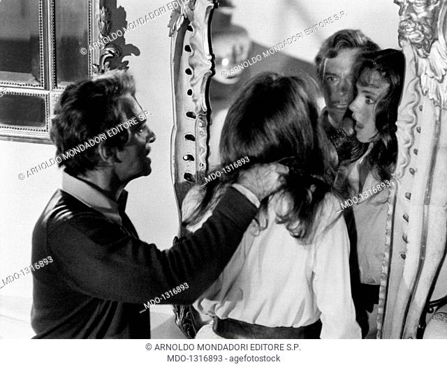 Jacqueline Bisset attacked by Christopher Plummer in a scene of the film 'The Spiral Staircase'. Christopher Plummer forces Jaqueline Bisset to look at a mirror