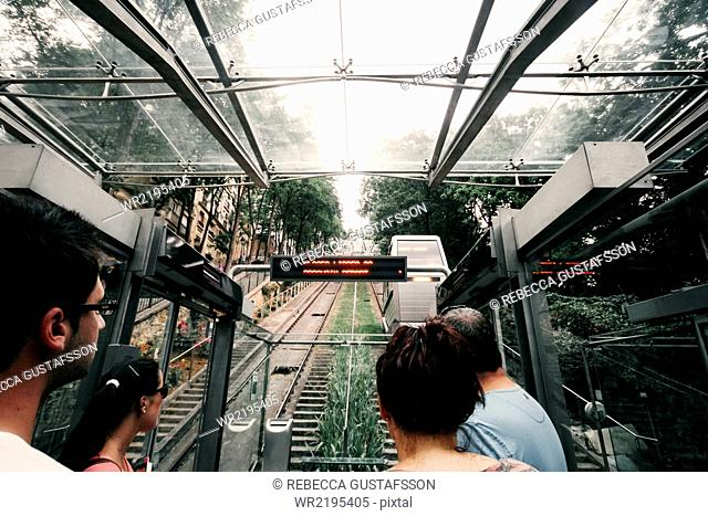 Tourists traveling in funicular railway