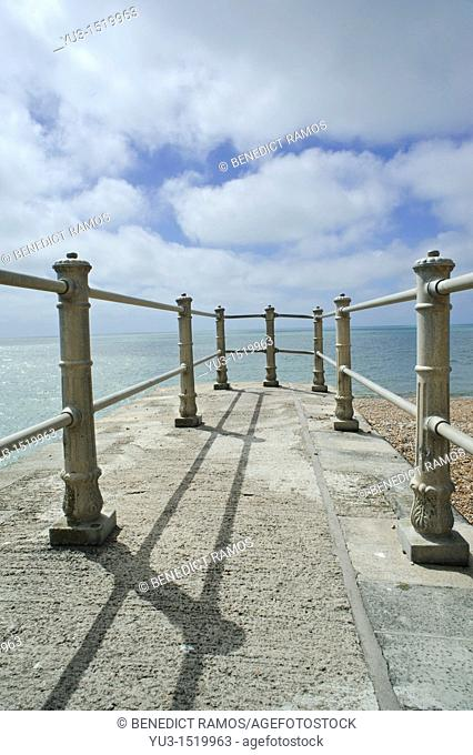 Small fenced pier on the beach at Hastings, East Sussex, England  UK