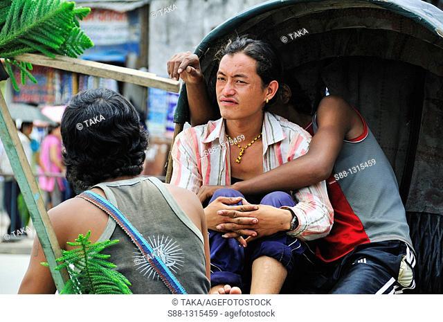 Young Rikisya men waiting customer