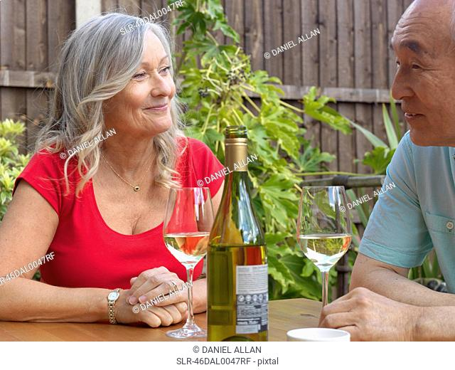 Older couple drinking wine together
