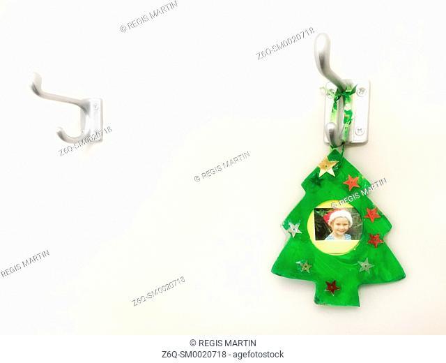 Christmas memorabilia on a coat hanger