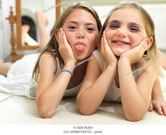 Friends showing make-up experiments