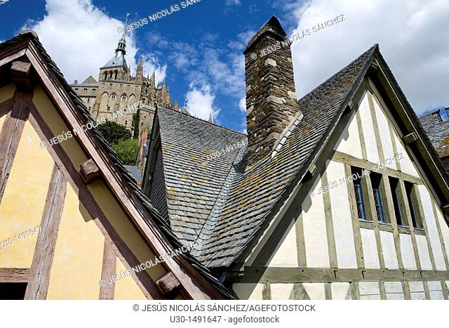 Typical and old houses with half-timbered, under Mont-Saint Michel abbey, listed as World Heritage by UNESCO, Manche department, Lower Normandie region, France