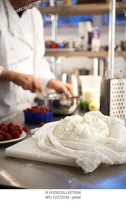 Preparing a quark dessert with berries