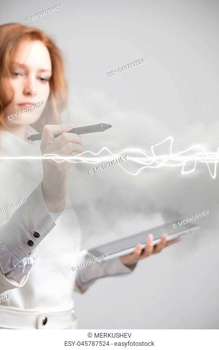 Young woman making magic effect - flash lightning. The concept of electricity, high energy