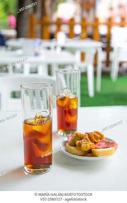 Spanish aperitif: two glasses of vermouth and tapa in a terrace. Spain