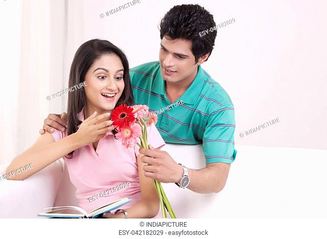 Man giving flowers to his girl friend