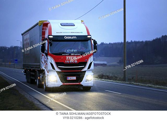 Salo, Finland - December 16, 2018: Biogas fueled Iveco Stralis NP truck L. Retva Oy pulls FREJA freight trailer along highway on a dark, cloudy winter evening