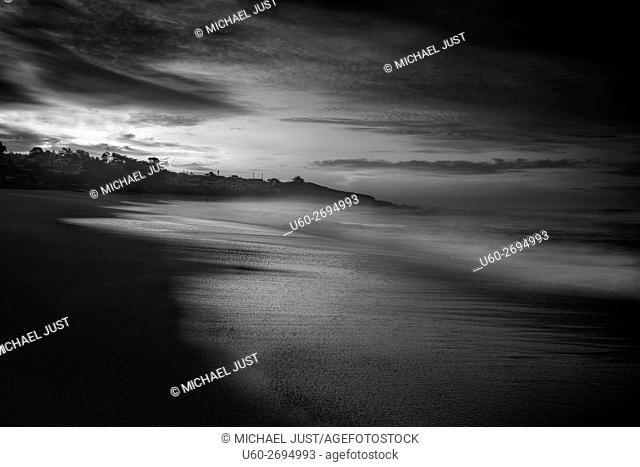 The sun rises over the Pacific Ocean at Cambria, California