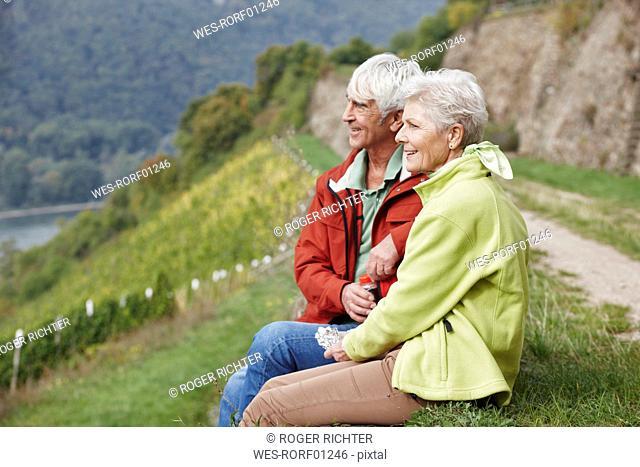 Germany, Rheingau, hiking senior couple having a rest