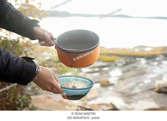 Preparing food at lakeside, Maine, USA