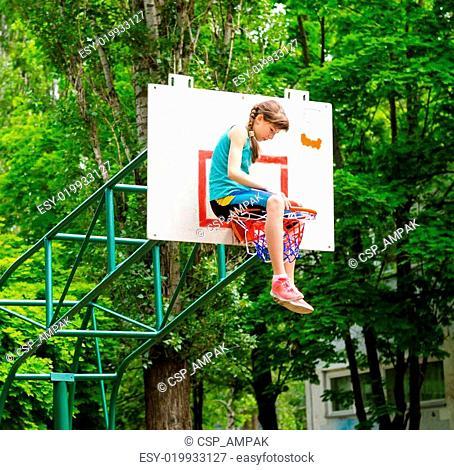 Young girl sitting in hoop