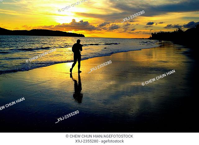A beach at sundown with Pantai Cenang of the island Langkawi in Malaysia in southeast Asia