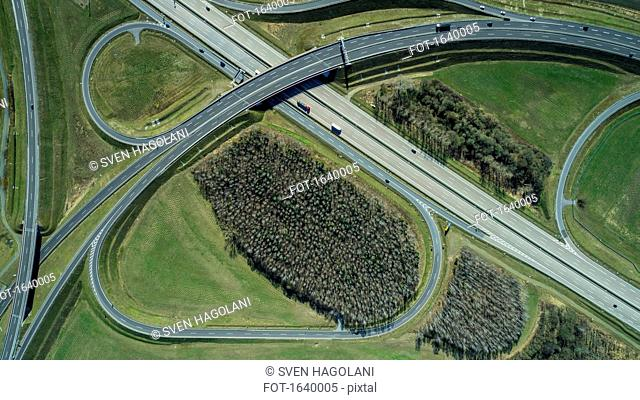 Aerial view of highways in field during sunny day, Berlin, Brandenburg, Germany
