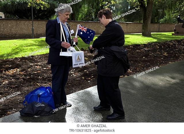 Woman Selling Flags On Anzac Day Adelaide Australia