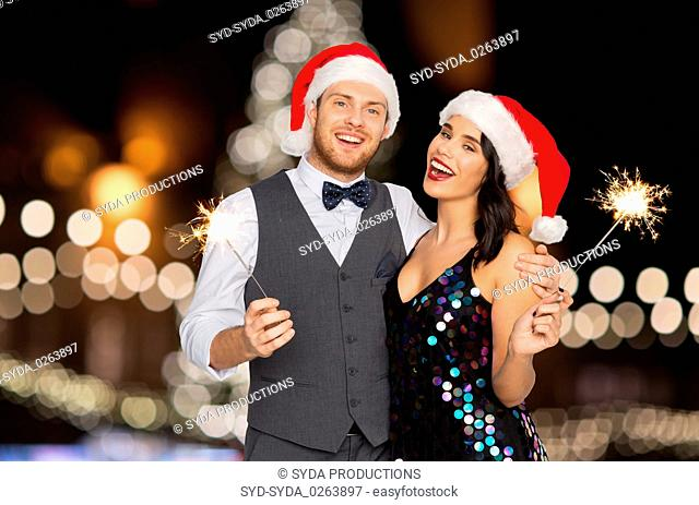 happy couple with sparklers at christmas party
