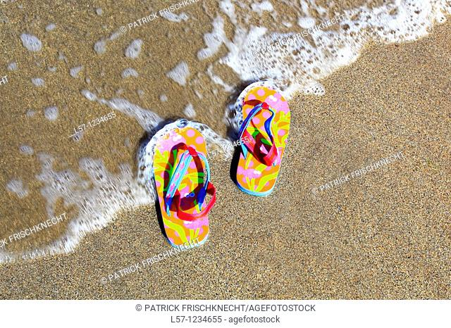 flip-flops on sandy beach, Sutherland, Scotland