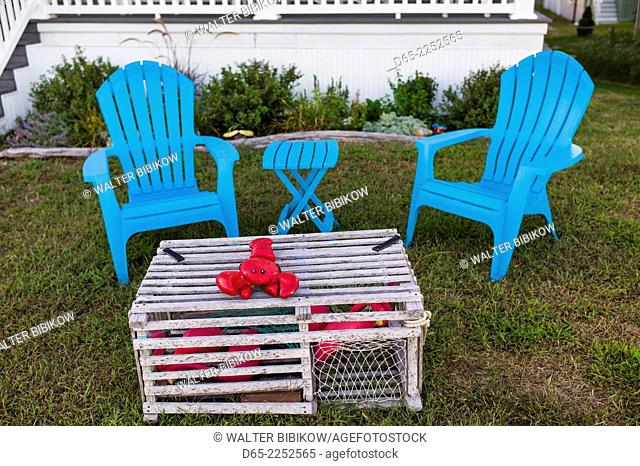 USA, Massachusetts, Rockport, Long Beach, lawn chairs with lobster