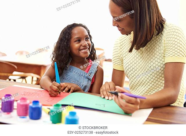Mother Painting Picture With Daughter At Home