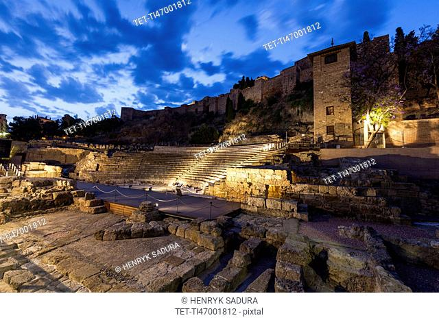 Spain, Andalusia, Malaga, Illuminated Roman Theater at dusk